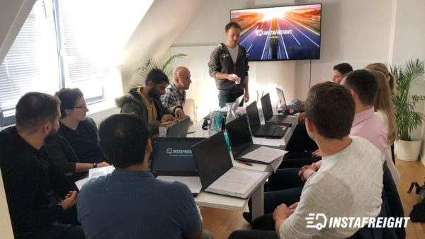 A group of new InstaFreight employees during their onboarding process.